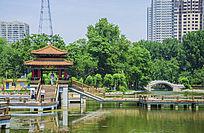 鞍山人防公园英泽湖水上凉亭与复拱石桥