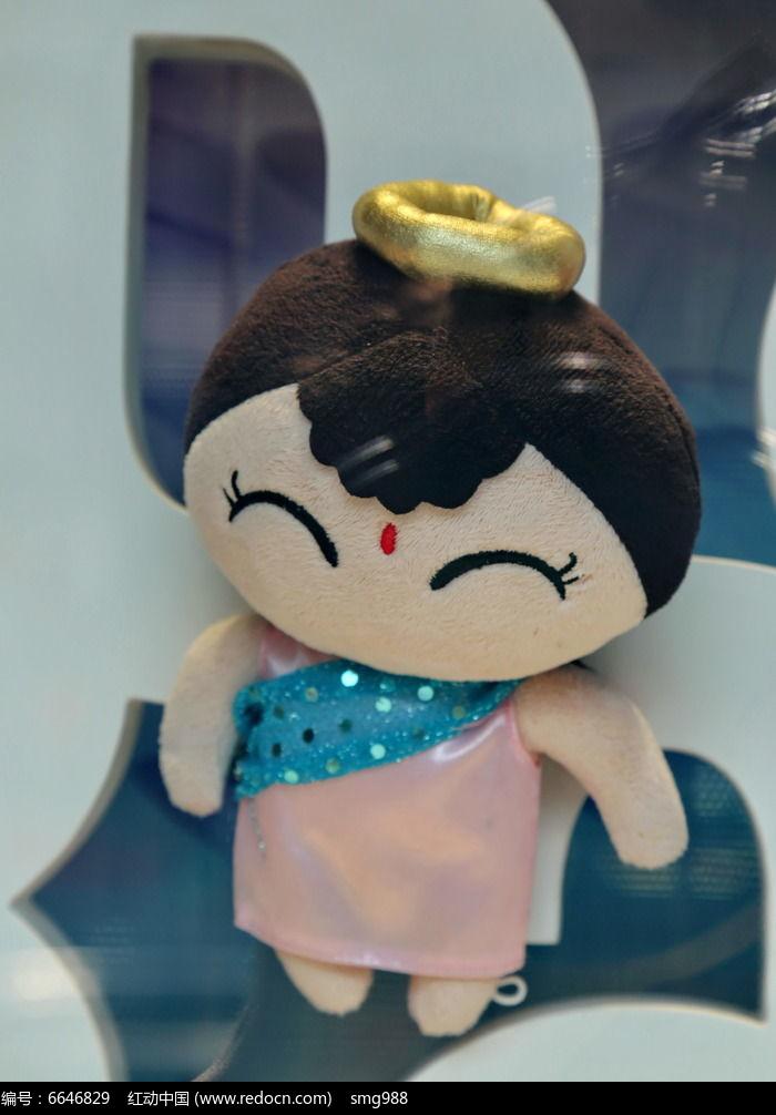 戴头冠的可爱布娃图片