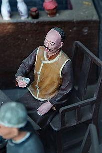 泥塑古代酒桌上人物