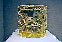 黄釉雕瓷棋琴书画图笔筒