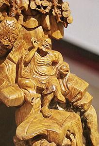 黄花梨木雕罗汉掏耳朵