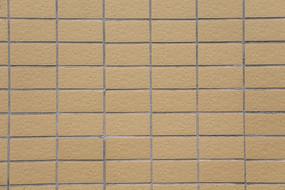 淡黄色的瓷砖墙