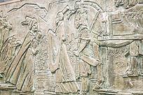 墙面的古代人物雕塑