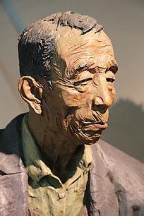 彩色雕塑老人侧面头像