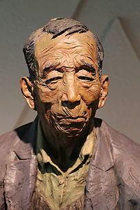 彩色雕塑老人头像