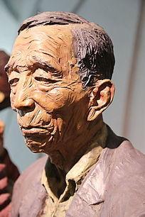 彩色雕塑皱纹老人头像
