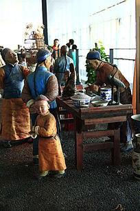 泥塑喝茶的人物