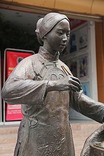 铜雕卖早点的少妇