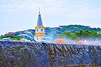 蓝色水流人工瀑布和雕塑蓝色海豚