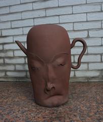 人头像茶壶雕塑
