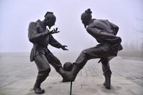 石雕人物踢球
