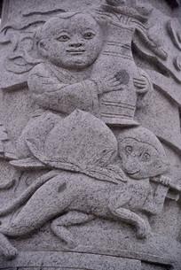 石雕图案孩童和石猴