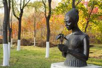 雕塑第一束花非洲少女