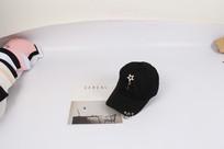 黑色个性星星带环棒球帽摄影图