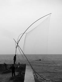 滇池边捕鱼清网