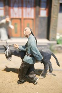 彩色泥塑赶毛驴的长辫子古人