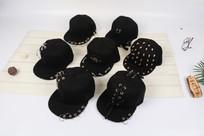 黑色个性平顶帽摄影图