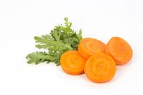 红萝卜片和萝卜叶子
