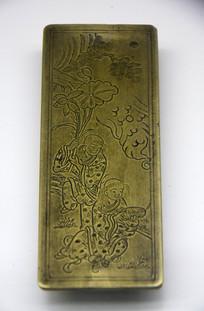 人物纹理铜镇纸