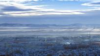 额尔古纳湿地白雪覆盖麦田村镇