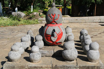 拉祜族葫芦形图腾石刻