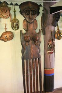 木刻女人像与面具