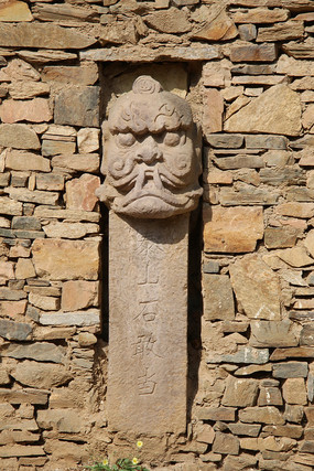 石刻刻龙头图腾石墙背景