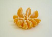 剥皮时令水果橘子瓣摄影图片