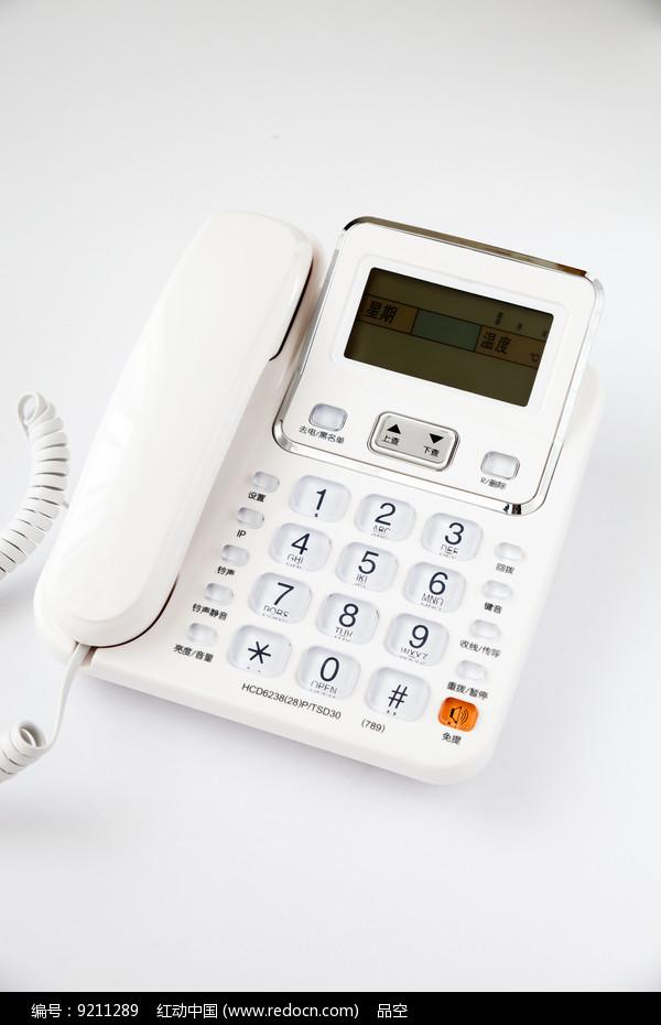 一台带有液晶显示的白色电话机图片
