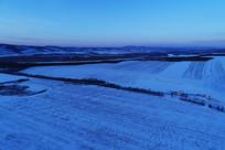 航拍蓝色田野雪景