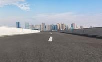 前景为沥青道路的厦门城市风光