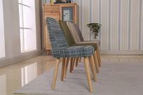 美丽的中性色布艺椅子侧面