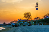 北戴河老虎石公园海滩夕阳建筑