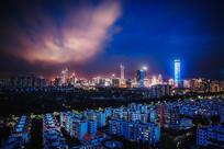 蓝色调紫色云的都市夜景