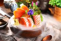 三文鱼海鲜拼盘摄影图