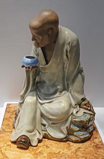 刘传款青釉托钵罗汉坐石像