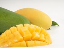 新鲜多汁黄色青色芒果摄影图片