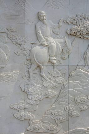 祥云上的倒骑毛驴的张果老壁雕