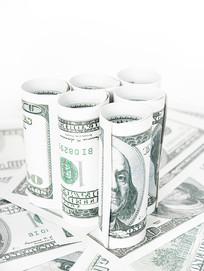 卷起来的美元创意图片