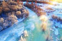 航拍冰河河湾树林朝阳