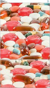 旋转的彩色药片胶囊保健品高清实拍视频素材