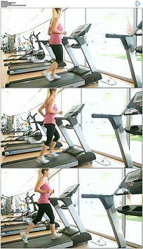 美女健身房跑步机跑步实拍视频素材
