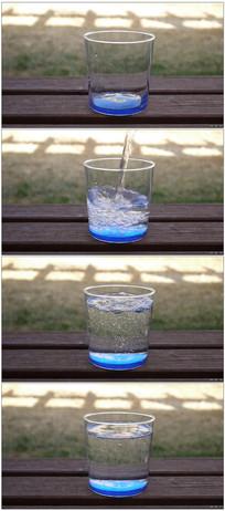 水杯倒入纯净水冲击产生气泡