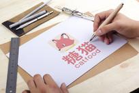 手绘卡通粉红色猫LOGO