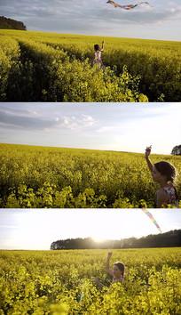 女孩花田放风筝实拍视频素材
