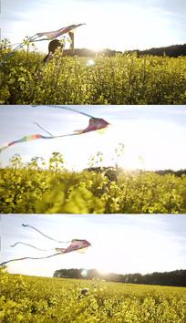 油菜花田放风筝实拍视频素材