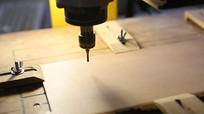 数控钻头正在木板上钻孔视频素材
