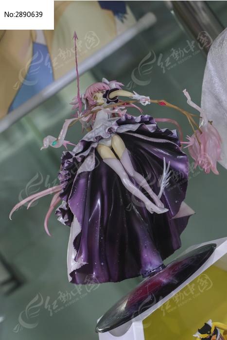 紫色大波浪拿弓美女人偶图片