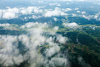 航拍  鸟瞰云雾下的绿色家园