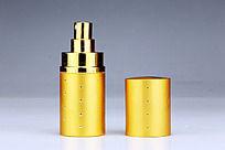 黄色的香水瓶与瓶盖